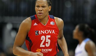 Washington Mystics forward Monique Currie reacts after scoring in Game 3 of a WNBA basketball Eastern Conference semifinal series against the Atlanta Dream, Monday, Sept. 23, 2013, in Atlanta. (AP Photo/Todd Kirkland)