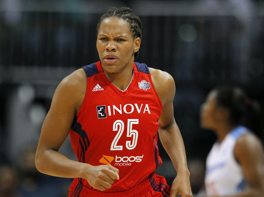 Washington Mystics forward Monique Currie reacts after scoring in Game 3 of aWNBA basketball Eastern Conference semifinal series against the Atlanta Dream, Monday, Sept. 23, 2013, in Atlanta. (AP Photo/Todd Kirkland)