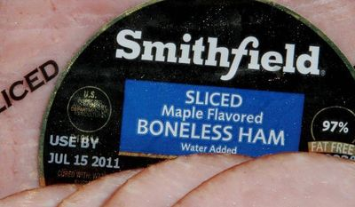 ** FILE ** Smithfield Foods, the top pork producer in the U.S., has planned a $4.7 billion buyout from Shuanghui International Holdings Ltd. (Associated Press)