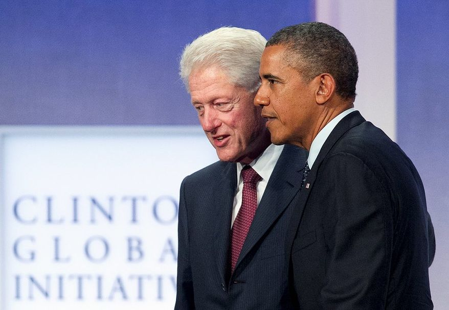 President Obama joins former President Bill Clinton on Tuesday at the Clinton Global Initiative in New York, where they touted the Affordable Care Act. (Associated Press)