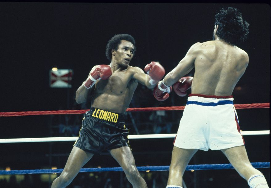 """**FILE** Sugar Ray Leonard (left) is seen in action against Robert Duran on Nov. 25, 1980, at the Louisiana Superdome in New Orleans. Leonard won the WBC Welterweight title fight after Duran quit with sixteen seconds left in the eighth round, telling the referee """"No mas,"""" Spanish for """"no more."""" (Associated Press)"""