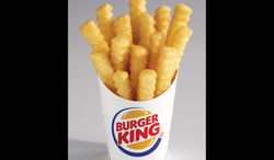 "Burger King says its new french fries, dubbed ""Satisfries,"" have 20 percent fewer calories than its regular fries. Satisfries will cost about 30 cents more than regular fries. (AP Photo/Burger King, Noel Barnhurst)"