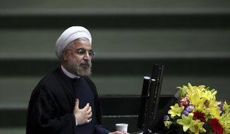 ** FILE ** In this Aug. 15, 2013, file photo, Iranian President Hasan Rouhani speaks during the debate on the proposed Cabinet at the parliament, in Tehran, Iran. (AP Photo/Ebrahim Noroozi, File)