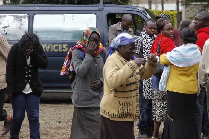 Family members outside the Nairobi City Mortuary in Nairobi mourn the death of loved ones killed in the Westgate attack in Nairobi, Kenya Tuesday, Sept. 24, 2013. (AP Photo/Khalil Senosi)