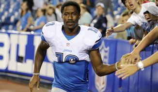 FILE - In this Aug. 29, 2013 file photo, Detroit Lions wide receiver  Nate Burleson (13) walks away from fans after signing autographs after an NFL football game against the Buffalo Bills in Orchard Park, N.Y. The Detroit Lions say Burleson was in a one-car accident and needs surgery on a broken arm. The team said in a statement Tuesday morning, Sept. 24, 2013, that the police have confirmed alcohol was not involved. (AP Photo/Gary Wiepert, File)