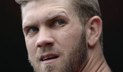 Washington Nationals left fielder Bryce Harper (34) before the start of a baseball game against the Miami Marlins at Nationals Park in Washington, Sunday, Sept. 22, 2013. (AP Photo/Susan Walsh)