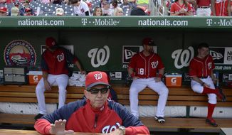 Washington National manager Davey Johnson waits in the dugout before a baseball game against the Miami Marlins at Nationals Park in Washington, Sunday, Sept. 22, 2013. Johnson announced earlier in the season that this would be his last year managing the Nationals. The Nationals organization paid tribute to Johnson before the game, presenting him with a video tribute and a crystal award.  (AP Photo/Susan Walsh)
