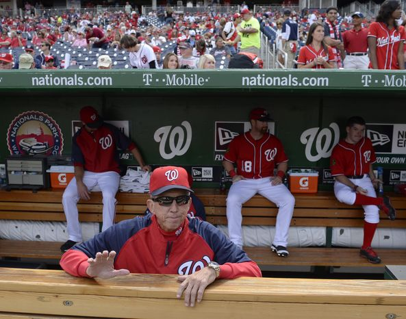 Washington National manager Davey Johnson waits in the dugout before a baseball game against the Miami Marlins at Nationals Park in Washington, Sunday, Sept. 22, 2013. Johnson announced earlier in the season that this would be his last year managing the Nationals. The Nationals organization paid tribute to Johnson before the game, presenting him with a video tribute and a crystal award.  (AP P