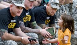 A young spectator interacts with members of the Ranger Training Battalions during the 2010 Best Ranger Competition, Fort. Benning, Ga., May 08, 2010. Families and spectators were allowed to view specific portions of the competitions to cheer on their teams. DoD photo by Daren Reehl