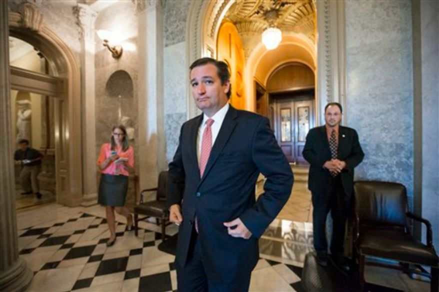 "Sen. Ted Cruz, R-Texas, leaves the floor of the Senate after skirmishing with Senate Majority Leader Harry Reid, D-Nev., over the Affordable Care Act, popularly know as ""Obamacare,"" at the Capitol in Washington, Monday, Sept. 23, 2013. (AP Photo/J. Scott Applewhite)"