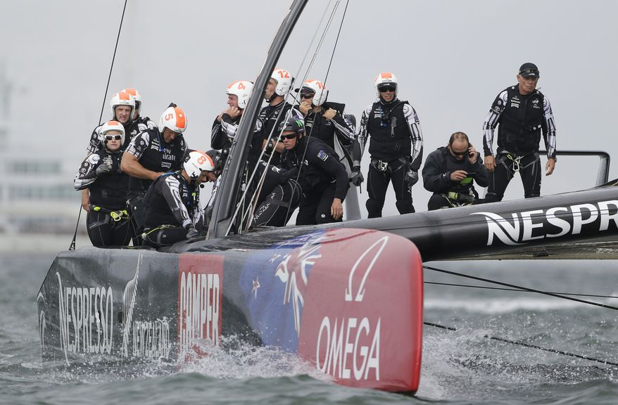Emirates Team New Zealand crew prepares for the re-sail of the 13th race of the America's Cup sailing event against Oracle Team USA, Friday, Sept. 20, 2013, in San Francisco. At right is grinder and team CEO Grant Dalton. The first running of the 13th race was abandoned because of a time limit with the Kiwis far ahead of Oracle Team USA in light, shifty wind. (AP Photo/Eric Risberg)