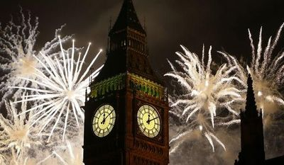 ** FILE ** Fireworks explode over the Palace of Westminster's Elizabeth Tower, which houses Big Ben, in London on Tuesday, Jan. 1, 2013. (AP Photo/Kirsty Wigglesworth)