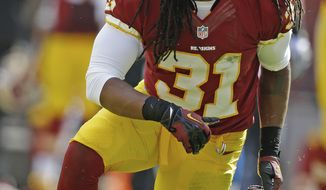 Washington Redskins strong safety Brandon Meriweather gets up after a tackle during the first half of a NFL football game against the Detroit Lions in Landover, Md., Sunday, Sept. 22, 2013. (AP Photo/Alex Brandon)