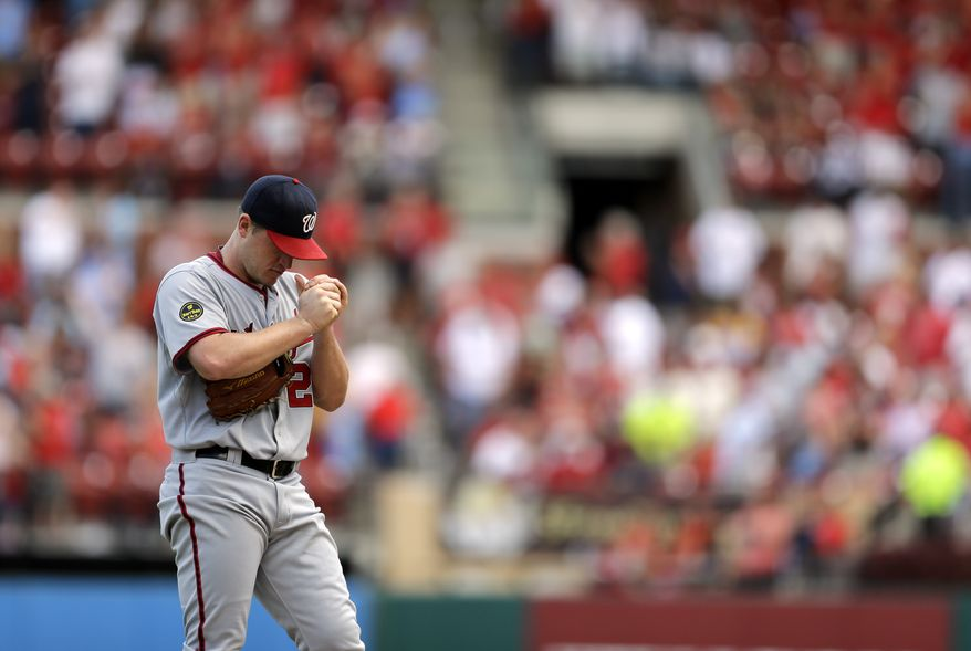 Washington Nationals starting pitcher Jordan Zimmermann rubs up a new baseball after giving up a solo home run to St. Louis Cardinals' Matt Adams during the sixth inning of a baseball game Wednesday, Sept. 25, 2013, in St. Louis. (AP Photo/Jeff Roberson)