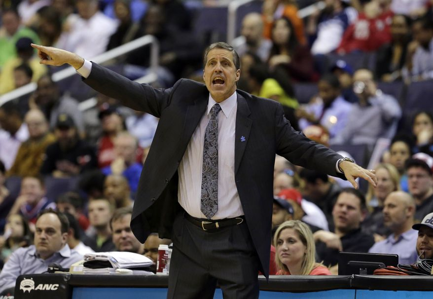 "FILE - In this April 2, 2013 file photo, Washington Wizards head coach Randy Wittman directs his team in the first half of an NBA basketball game against the Chicago Bulls in Washington. The aim is pretty clear for Wall and the rest of the Washington Wizards: get to the postseason. Team president Ernie Grunfeld says so. As does coach Randy Wittman. Speaking at a joint news conference Wednesday, Grunfeld says, ""Our initial goal is to be a playoff contender and, ultimately, by the end of the year, make the playoffs."" Wittman adds, ""We want to make the playoffs. ... And there's no reason why we can't.""  Washington went 29-53 last season, missing out on the postseason for the fifth consecutive year.(AP Photo/Alex Brandon, File)"