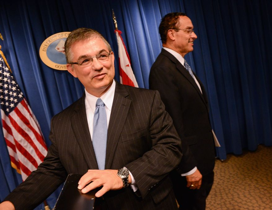 Jeffrey S. DeWitt (left), Phoenix's chief financial officer, was announced by D.C. Mayor Vincent C. Gray as his pick to serve as D.C.'s next chief financial officer, subject to D.C. Council approval. The District is reviewing options if a federal shutdown occurs. (andrew harnik/the washington times)