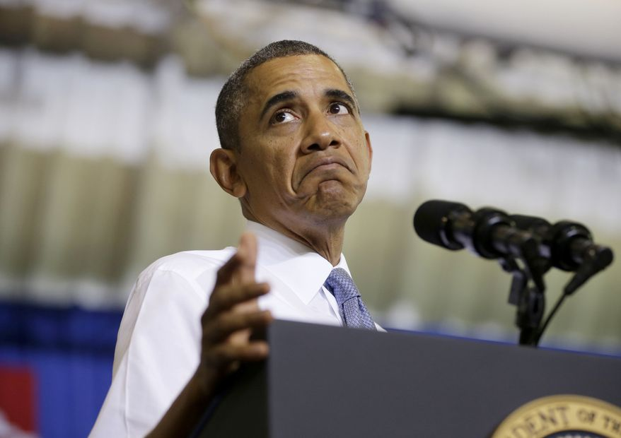 President Obama pauses while speaking about the Affordable Care Act on Sept. 26, 2013, at Prince George's Community College in Largo, Md. The president is promoting the benefits of his health care law before new insurance exchanges open for business next week. (Associated Press)