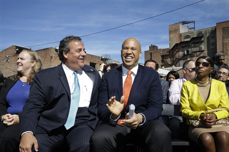 New Jersey Gov. Chris Christie, center left, laughs with Newark Mayor and Senate candidate Cory Booker in Newark, N.J., Wednesday, Sept. 25, 2013, during a ribbon-cutting ceremony for Newark charter schools. (AP Photo/Mel Evans)