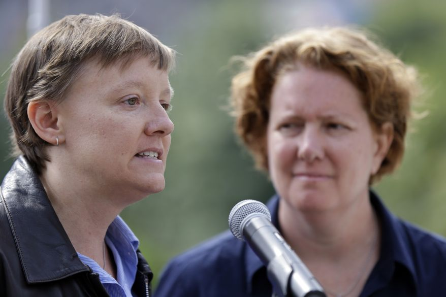 Isabelle Barker (left) and her spouse, Cara Palladino, speak during a news conference on Thursday, Sept. 26, 2013, near Independence Hall in Philadelphia. The two, who were legally married in Massachusetts and later moved to Pennsylvania, have filed a federal lawsuit aiming to overturn a state law stating that same-sex marriages, including those recorded elsewhere, are not legal within the commonwealth. (AP Photo/Matt Rourke)