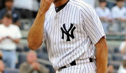 ** FILE ** New York Yankees' Mariano Rivera blows a kiss to the crowd to acknowledge cheers after recording his 602nd save as the Yankees beat the Minnesota Twins 6-4 in a baseball game at Yankee Stadium in New York, Sept. 19, 2011. (Associated Press)