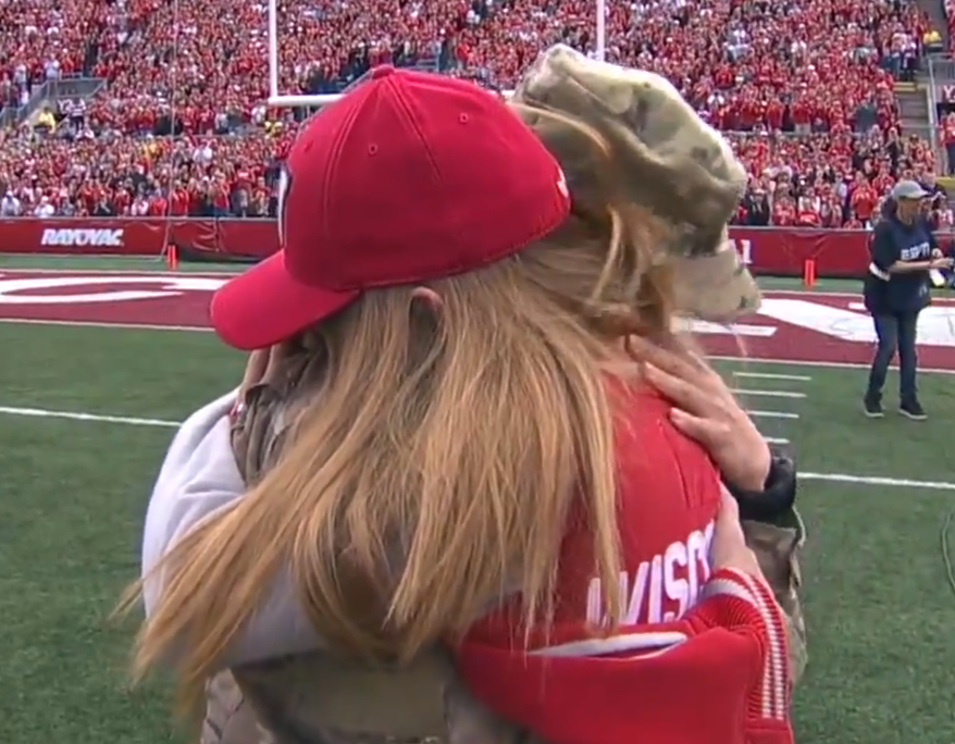 Army Capt. Captain Jane Renee Lund surprises her daughter, Bella, with an early return from Afghanistan in front of 80,000 fans at the University of Wisconsin's Camp Randall Stadium.