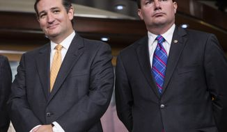 **FILE** Republican Sens. Ted Cruz (left) of Texas and Mike Lee of Utah stand during a news conference with conservative congressional Republicans at the Capitol in Washington on Sept. 19, 2013. (Associated Press)