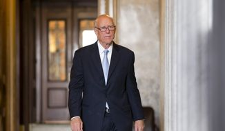 "**FILE** Sen. Pat Roberts, Kansas Republican, leaves the Senate after assisting fellow Republican Sen. Ted Cruz of Texas with his overnight fight on the floor against the Affordable Care Act, popularly known as ""Obamacare,"" at the U.S. Capitol in Washington on Sept. 25, 2013. Cruz and other conservative Republicans were trying to delay a must-pass spending bill. (Associated Press)"