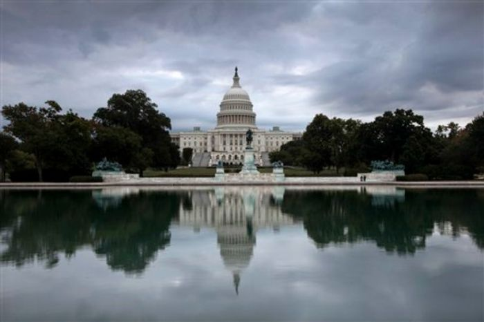 Storm clouds hang over Capitol Hill in Washington, Friday, Sept. 27, 2013, as the Republican-controlled House and the Democrat-controlled Senate stand at an impasse with Congress continuing to struggle over