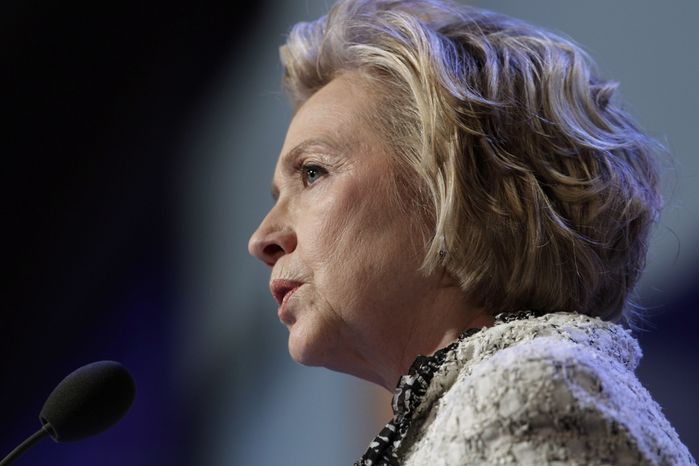 """Former Secretary of State Hillary Rodham Clinton speaks at a seminar on """"Women Decision-Makers in the Global Economy"""" at the Clinton Global Initiative on Wednesday, Sept. 25, 2013, in New York. (AP Photo/Mark Lennihan)"""