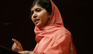 Malala Yousafzai addresses students and faculty after receiving the 2013 Peter J. Gomes Humanitarian Award at Harvard University on Friday, Sept. 27, 2013, in Cambridge, Mass. The Pakistani teenager, an advocate for education for girls, survived a Taliban assassination attempt last year on her way home from school. (AP Photo/Jessica Rinaldi)