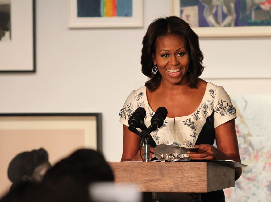 First lady Michelle Obama speaks during a luncheon at The Studio Museum of Harlem on Tuesday, Sept. 24, 2013, in New York. Mrs. Obama hosted the event for spouses of chiefs of state and heads of government participating in the U.N. General Assembly. (AP Photo/Tina Fineberg)