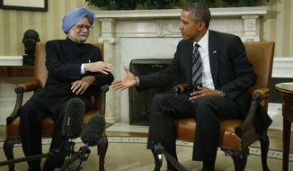 President Obama shakes hands with India's Prime Minister Manmohan Singh in the Oval Office at the White House in Washington on Sept. 27, 2013. (Associated Press)