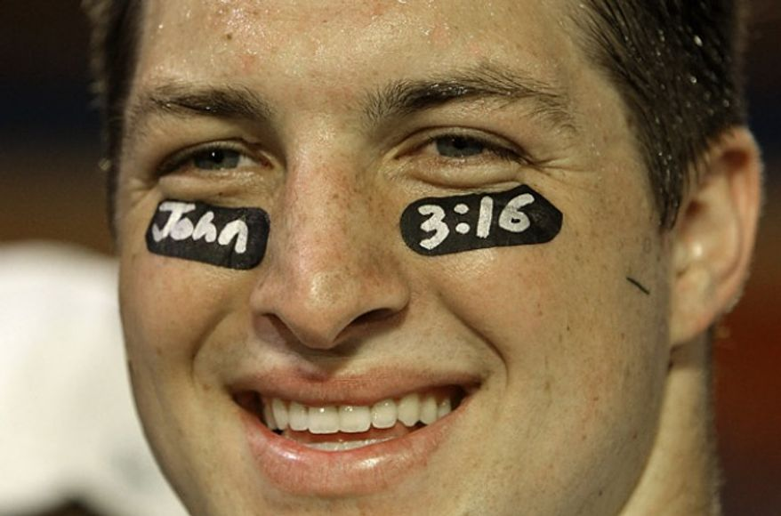 Quarterback Tim Tebow with a verse from the Gospel of John written on his eye black.
