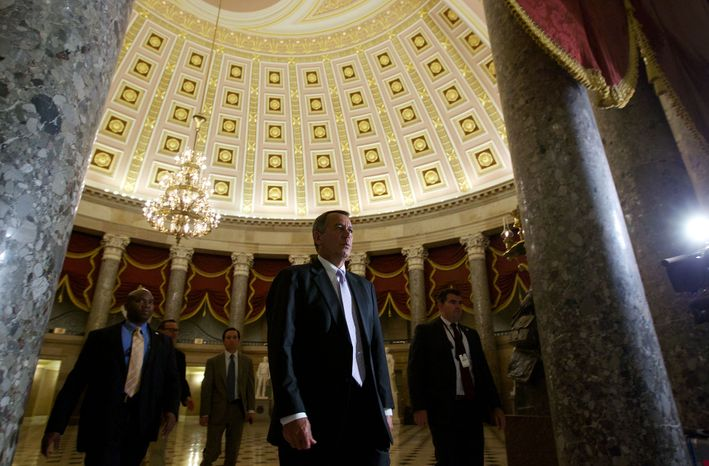 House Speaker John Boehner of Ohio, walks to the House Floor at the U.S. Capitol in Washington, Saturday, Sept. 28, 2013.  Lawmakers from both parties urged one another in a rare weekend session to give ground in their fight over preventing a federal shutdown, with the midnight Monday deadline fast approaching. But there was no sign of yielding Saturday in a down-to-the-wire struggle that tea party lawmakers are using to try derailing President Barack Obama's health care law.  (AP Photo/Molly Riley)