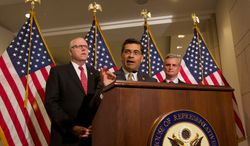 ** FILE ** Democratic Reps. Xavier Becerra (center) of California, Joseph Crowley (left) of New York and Robert E. Andrews of New Jersey address the media after a Democratic caucus meeting at the U.S. Capitol in Washington on Saturday, Sept. 28, 2013. (AP Photo/Molly Riley)