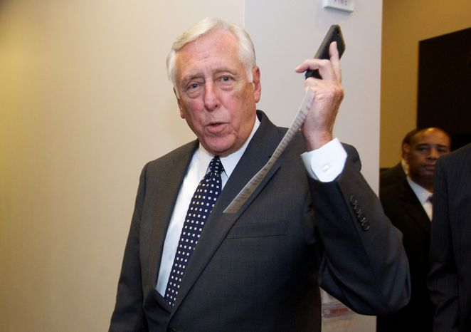 ** FILE ** House Minority Whip Steny Hoyer of Md. arrives for a Democratic Caucus meeting at the U.S. Capitol in Washington