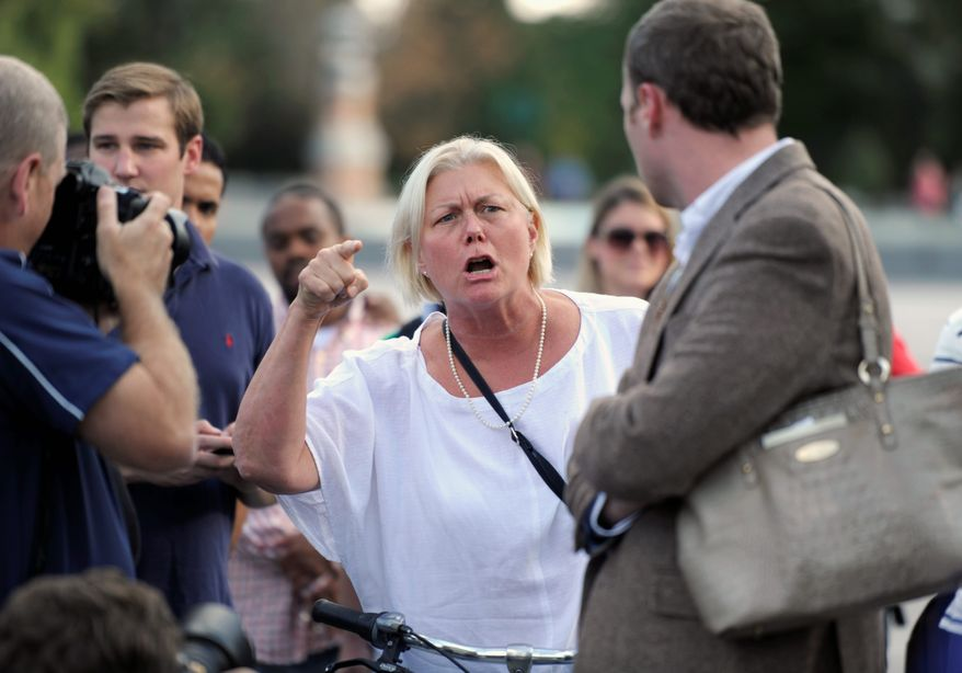 Cathryn Carroll, who lives in the District, expresses her displeasure of House Republicans as they rallied outside the Capitol and accused Senate Democrats of stalling.
