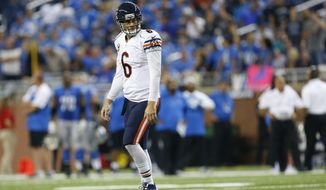 Chicago Bears quarterback Jay Cutler walks back to the bench during the fourth quarter of an NFL football game against the Detroit Lions in Detroit, Sunday, Sept. 29, 2013. The Lions won 40-32. (AP Photo/Paul Sancya)