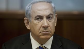 ** FILE ** Israeli Prime Minister Benjamin Netanyahu presides over his weekly Cabinet meeting in Jerusalem on Sunday, Sept. 1, 2013. (AP Photo/Abir Sultan, Pool)