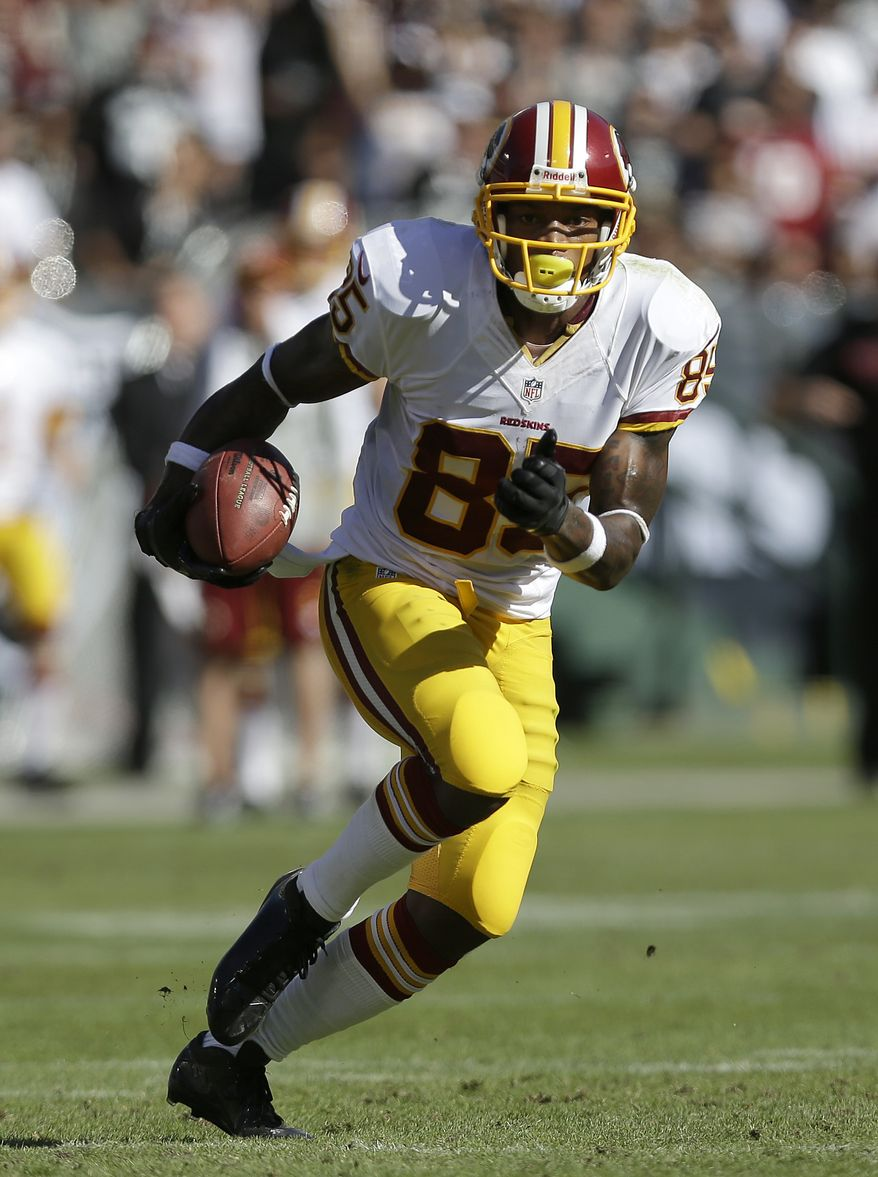 Washington Redskins wide receiver Leonard Hankerson (85) runs against the Oakland Raiders during the second half of an NFL football game in Oakland, Calif., Sunday, Sept. 29, 2013. (AP Photo/Marcio Jose Sanchez)