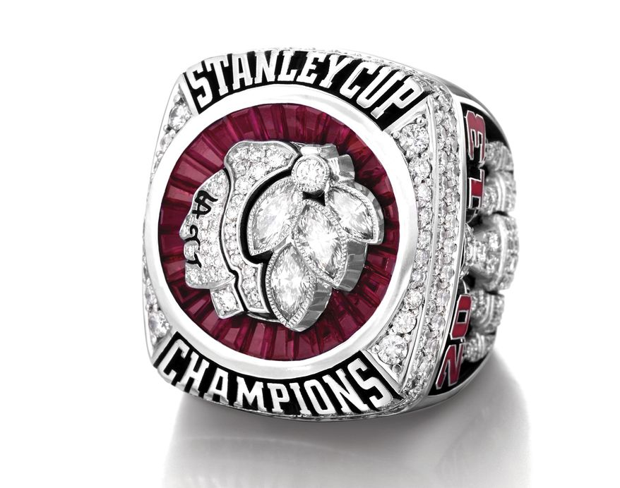 This undated photo provided by the Chicago Blackhawks shows the ring presented to the 2013 Stanley Cup-winning Blackhawks players during a private ceremony Sunday, Sept. 29, 2013, in Chicago. The team and Minneapolis-based jeweler Jostens collaborated on the design of the ring that features the Blackhawks logo with diamonds, emeralds and rubies. The Blackhawks won the NHL championship in June with victories over the Boston Bruins. (AP Photo/Courtesy of the Chicago Blackhawks)
