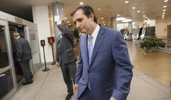 """Sen. Ted Cruz, R-Texas, returns to his Capitol Hill office after the Senate once again rejected the House version of the government funding bill, Monday night, Sept. 30, 2013, in Washington. The Republican-controlled House and the Democrat-controlled Senate are at an impasse as Congress continues to struggle over how to prevent a possible shutdown of the federal government when it runs out of money. President Barack Obama ramped up pressure on Republicans Monday to avoid a post-midnight government shutdown, saying that failure to pass a short-term spending measure to keep agencies operating would """"throw a wrench into the gears"""" of a recovering economy. (AP Photo/J. Scott Applewhite)"""