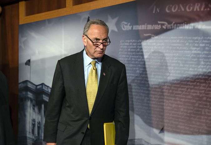Sen. Charles E. Schumer, New York Democrat, leaves a news conference after he and other party leaders spoke to reporters after the Democratic-led Senate rejected conditions that House Republicans attached to a temporary spending bill, at the Capitol in Washington on Monday, Sept. 30, 2013. (AP Photo/J. Scott Applewhite)