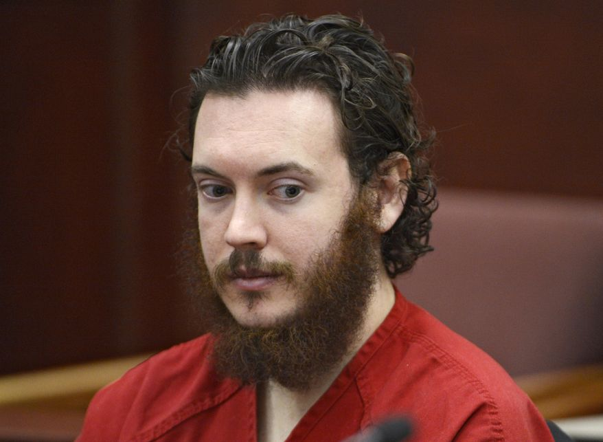 ** FILE ** This June 4, 2013, file photo shows Aurora theater shooting suspect James Holmes in court in Centennial, Colo. Holmes's lawyers asked the judge Monday, Sept. 30, 2013, to give them more time to file motions and to set deadlines for prosecutors to turn over a list of witnesses they plan to call. (AP Photo/The Denver Post, Andy Cross, Pool, File)
