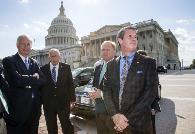 Sen. David Vitter, R-La., far right, assembles a group of conservative voices, including from left,  Sen. Ron Johnson, R-Wis., Sen. Mike Enzi, R-Wyo., Brian Baker, president of Ending Spending, to join him in criticizing the Affordable Care Act, at the Capitol in Washington, Monday, Sept. 30, 2013. Vitter told reporters that if Congress is going to write a law that forces Americans to use Obamacare through the individual mandate, then members of Congress should be prepared to do so as well. (AP Photo/J. Scott Applewhite)