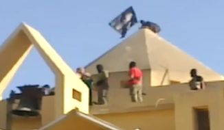 Video footage released by a news outlet in Dubai purportedly shows militants from the Islamic State of Iraq and the Levant, an umbrella organization of Iraqi insurgent groups operating in Syria, raising the al Qaeda flag above a Catholic church in the northern Syrian city of al-Raqqa.