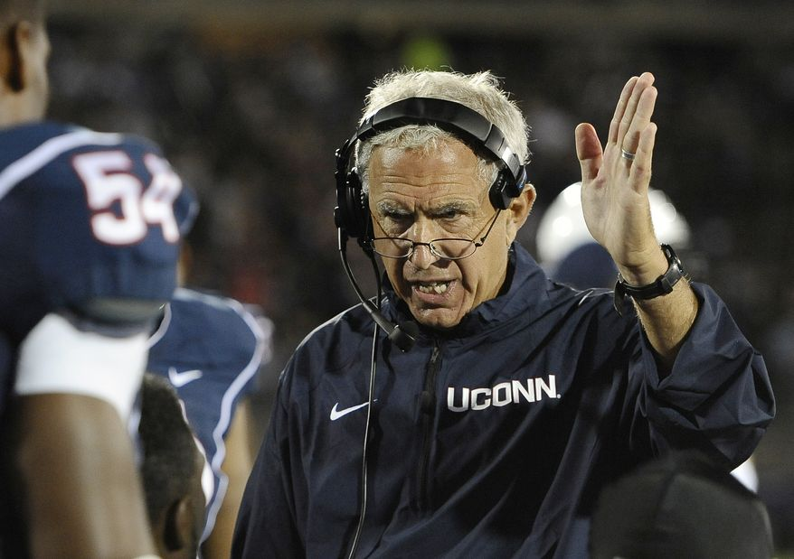 FILE - In this Sept. 21, 2013 file photo, Connecticut head coach Paul Pasqualoni, right, gestures to his team during the second half of an NCAA college football game against Michigan at Rentschler Field in East Hartford, Conn. Paqualoni was fired Monday, Sept. 30, 2013, after the Huskies lost the first four games of the season. (AP Photo/Jessica Hill, File)
