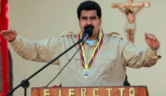 ** FILE ** In this photo released by Miraflores Press Office, Venezuela's Nicolas Maduro speaks to soldiers inside a military base in Coro, Venezuela, Monday, Sept. 30, 2013.  Maduro said Monday that his government was expelling the top U.S. diplomat in Venezuela and two other embassy employees for allegedly conspiring with the political opposition.  (AP Photo/Miraflores Press Office)