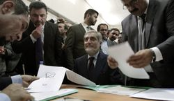 Abdullah Abdullah (center), a prominent Afghan opposition leader, registers his candidacy in next year's presidential election in Kabul, Afghanistan, on Tuesday, Oct. 1, 2013.  The election will be key in helping to determine the success or failure of 12 years of U.S.-led military and political intervention in the country. (AP Photo/Rahmat Gul)