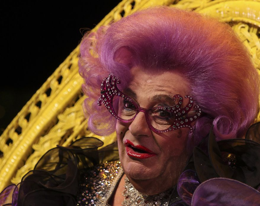 """Australian actor Barry Humphries, dressed as Dame Edna Everage speaks to the media ahead of her farewell show """"Eat Pray Laugh!""""  in Sydney, Australia Thursday, July 5, 2012. (AP Photo/Rob Griffith)"""